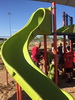 Volunteers help build a new playground at Foothills Community Park