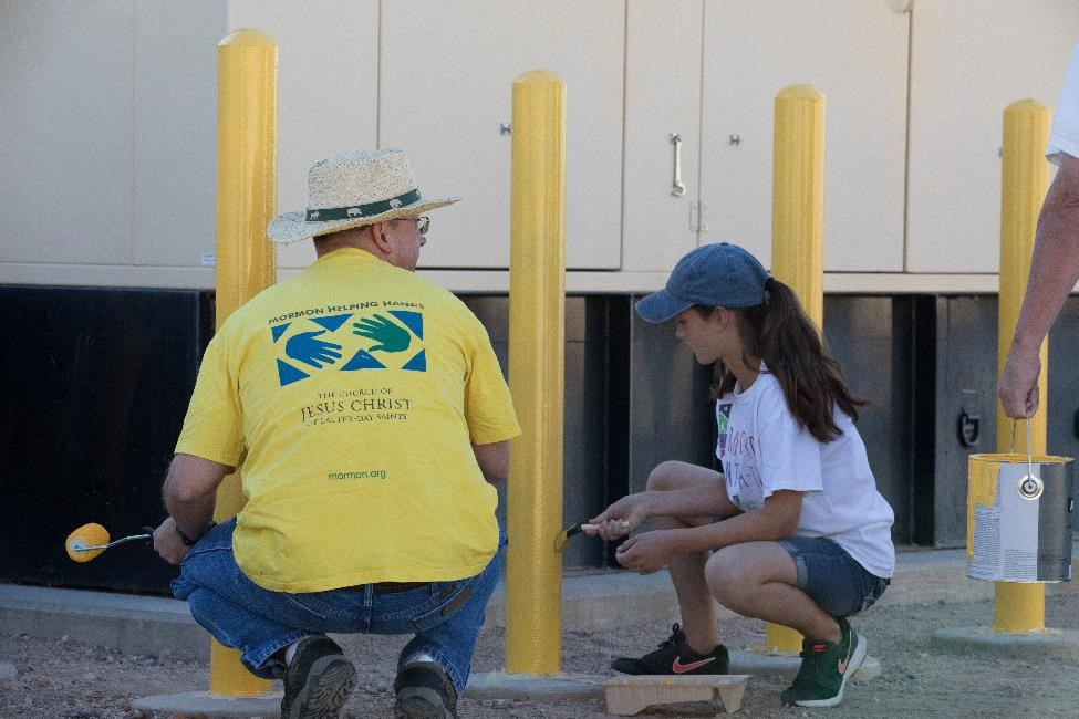 LDS volunteers painted safety bollards at the Bullard Water Campus.
