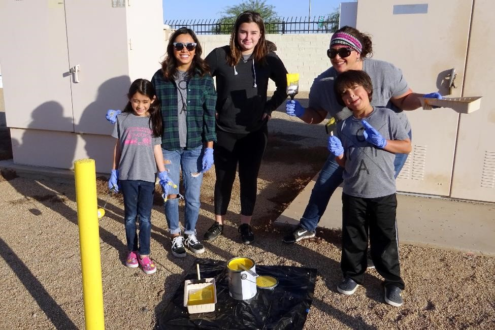 The Odyssey Prep Academy in Goodyear painted safety bollards at Well Site #18.