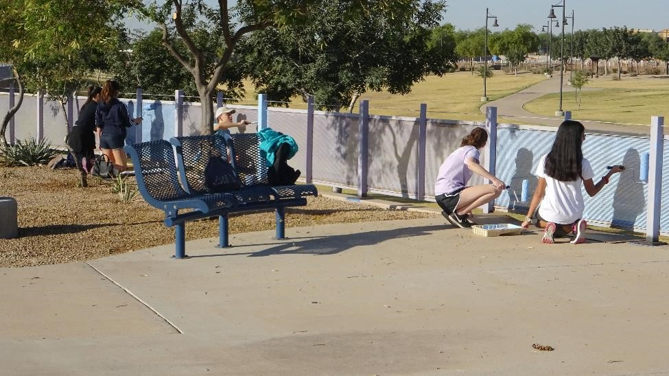 Estrella Foothills HS students painted Bullard Wash Phase 2 decorative railing.
